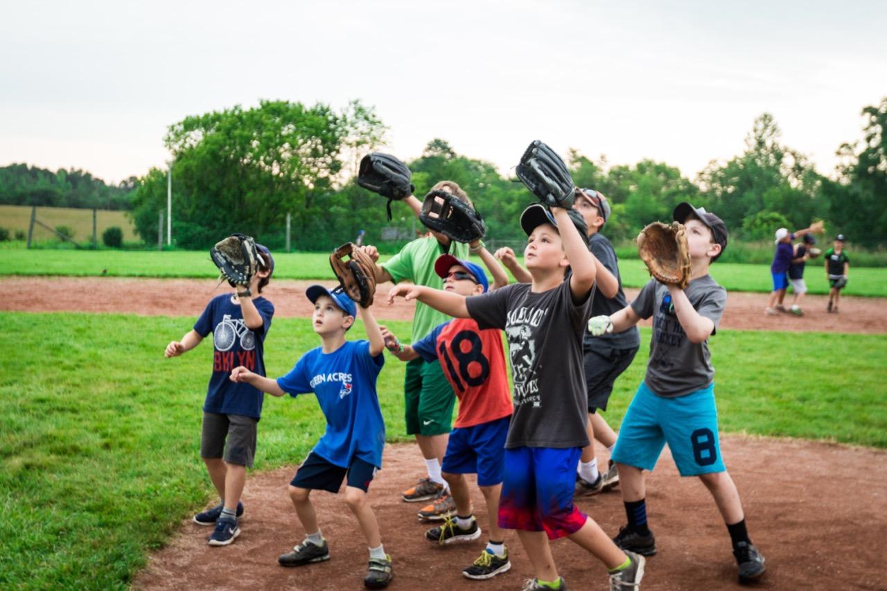 group of boys catching baseball