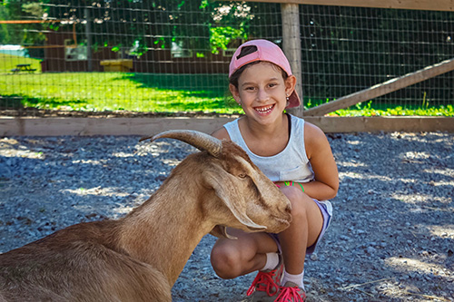 girl smiling with goat