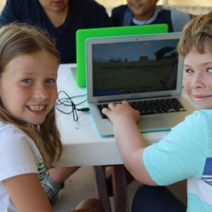 boy and girl using laptop