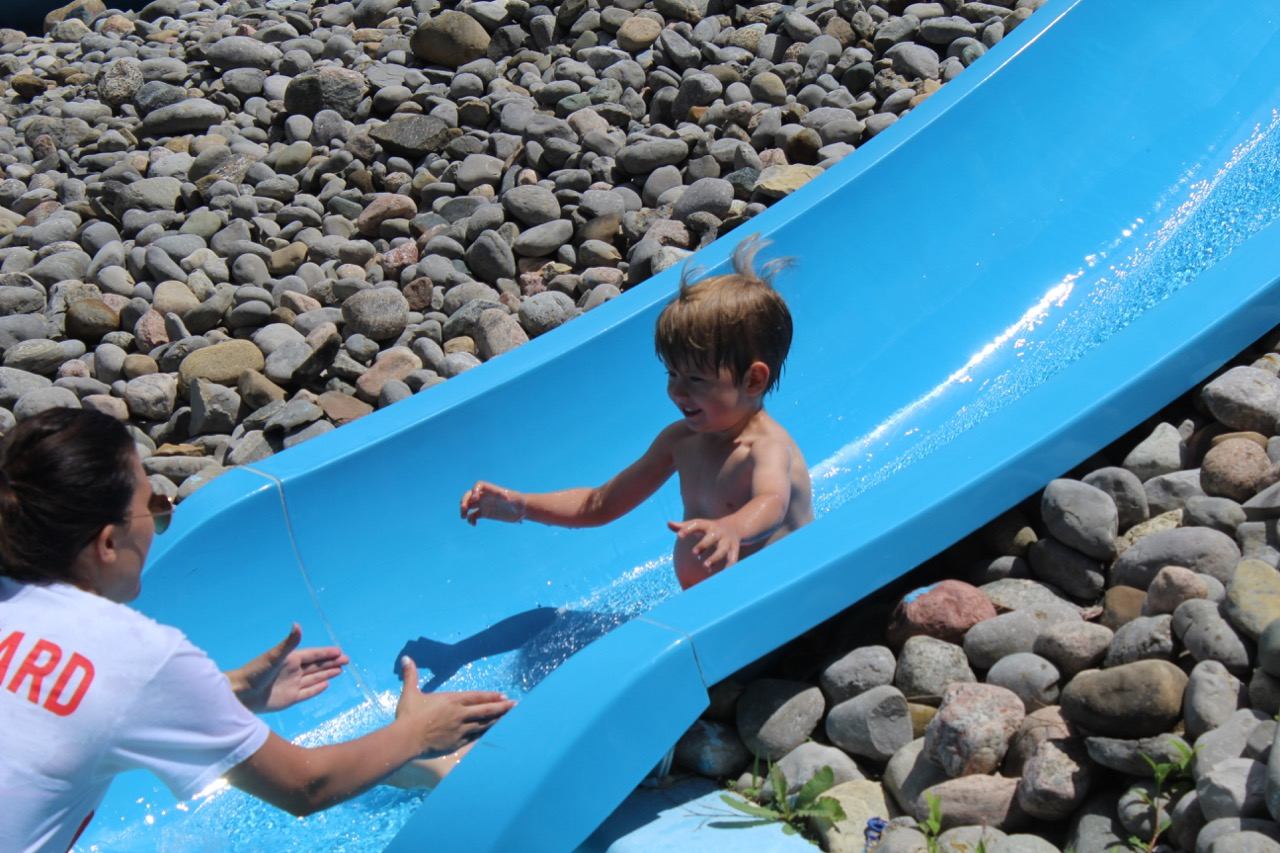 boy going down water slide