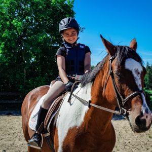 girl sitting on horse