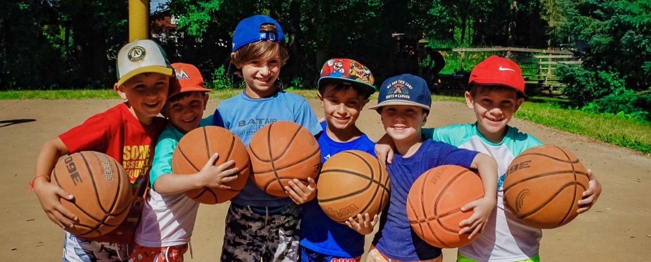 6 boys carrying basketballs