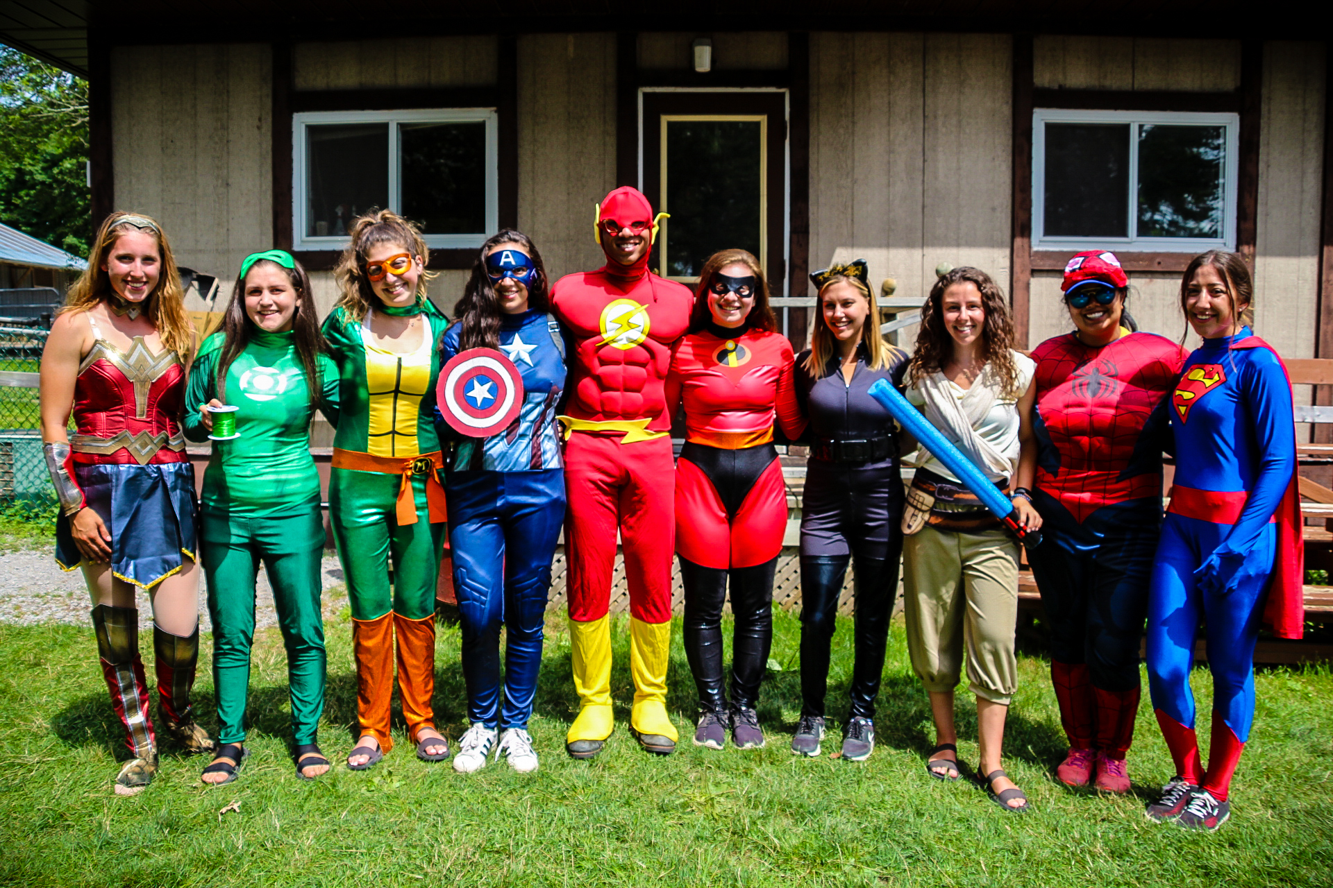 camp staff in super hero costumes