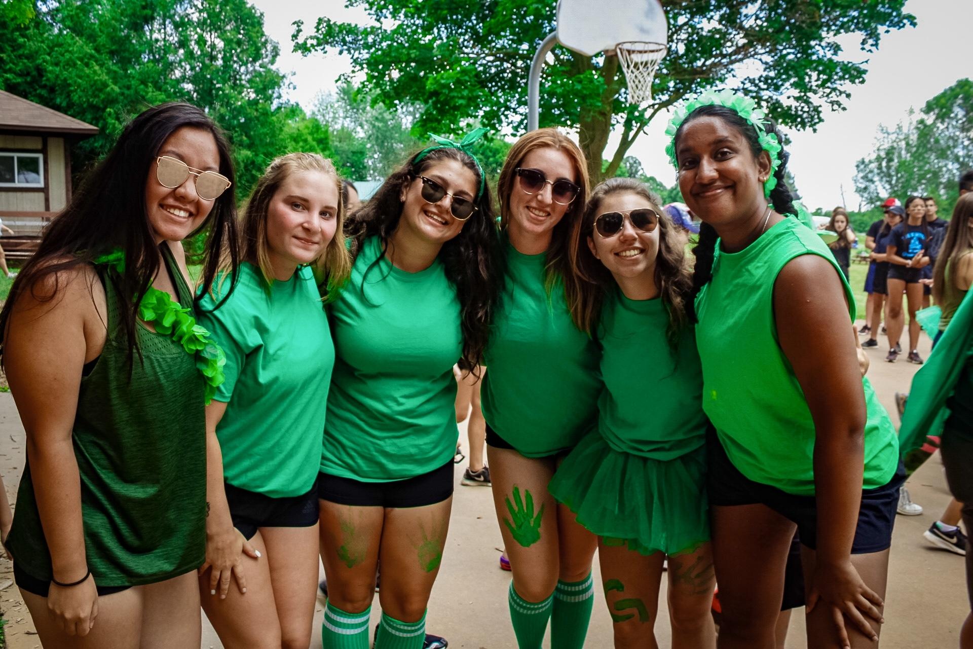 female camp staff all wearing green